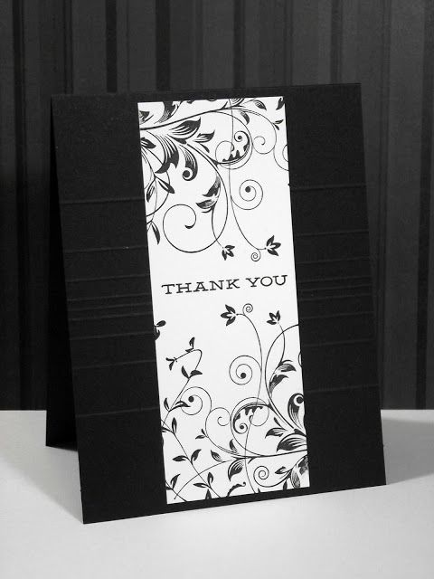handmade card ... black card ... panel down the middle with stamped wildflowers ... like it!