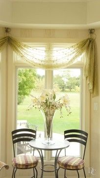 Sheer Swags Add A Bit Of Softness To This Bistro Table Area