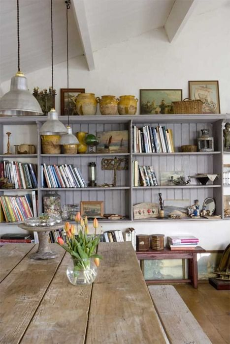 open shelves can house pantry items from serving dishes to canned goods, to dishes and table top, plus of course cook books-simple and more inexpensive way to maximize the space