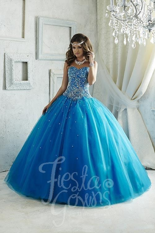A stunning gown with immaculate wave-like bead patterning, sweetheart neckline, lace-up back, and sequins spread upon the tulle ball gown skirt. Download the Fiesta Gowns by House of Wu sizing chart h