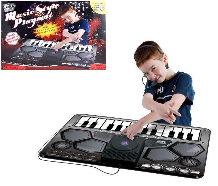 TAPETE DJ CONSOLA COMPLETA Conviértete en una superestrella con este tapete DJ consola completa,  con amplificador de CD/MP3 portátil incorporada y micrófono.