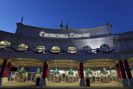 A night view of Churchill Downs front entrance gate