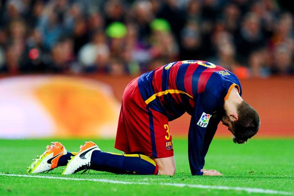 Gerard Pique of FC Barcelona reacts after missing a chance to score during the La Liga match between FC Barcelona and Valencia CF at Camp Nou on April 17, 2016 in Barcelona