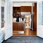 The walnut cabinets in the kitchen of this 1878 San Francisco original, which update and warm the space, were designed by Nilus de Matran...