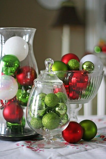 So simple, fill clear glass containers with colored ornaments in a color scheme