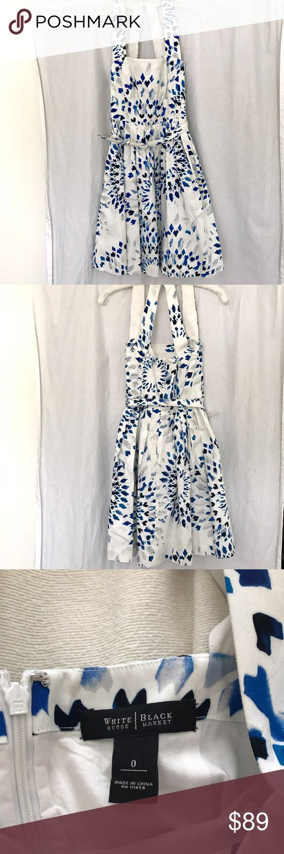 White House Black Market Dress Blue and White WHBM Dress Blue and White Pattern Size 0. See last photo for approximate measurements. One stain on the side (pictured) and some makeup transfer on the inside of the neck pieces (also pictured). Matching belt (also size 0) included. MAKE ME AN OFFER White House Black Market Dresses Midi