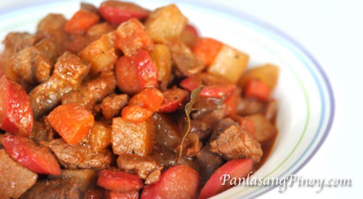 Pork Menudo is a Filipino pork stew dish with carrots and potato. It is stewed in a tomato based sauce and best eaten with rice.
