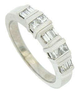 This handsome estate wedding band is fashioned of 14K white gold and set with alternating rows of baguette and square cut diamonds. The elongated prongs stretch across the face of the band to caress the sparkling stones. The Mid-Century Modern wedding ring measures 4.21 mm in width. Circa: 1950. Size 5. We can re-size.