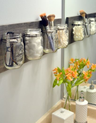 A Mason Jar Organizer - Declutter your bathroom with these fantastic Mason jars. If you can handle a drill, this shouldn't be too hard a task.
