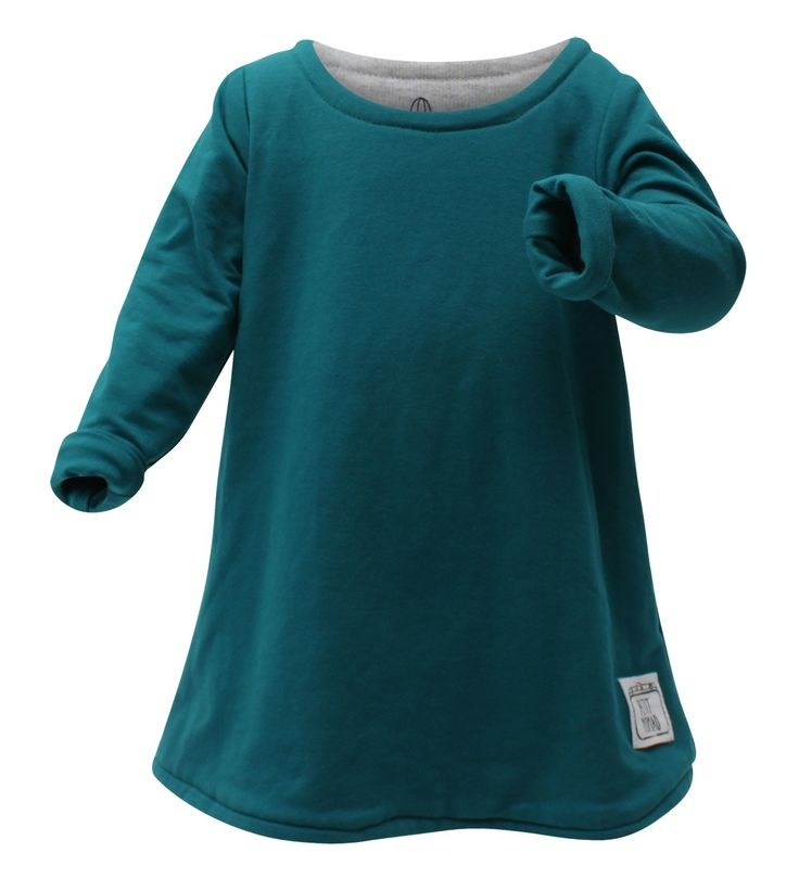 It's so warm and snuggly... a perfect dress for winter.  It's also a quick-change artist. Simply turn the turquoise dress inside out to showcase a trendy cactus print. The super easy-care cotton fabric is double layered and offers a comfy fit on your little girl.  Note! Our reversible dresses are designed to keep your little one clean throughout each day and promote independent dressing for creative toddlers!