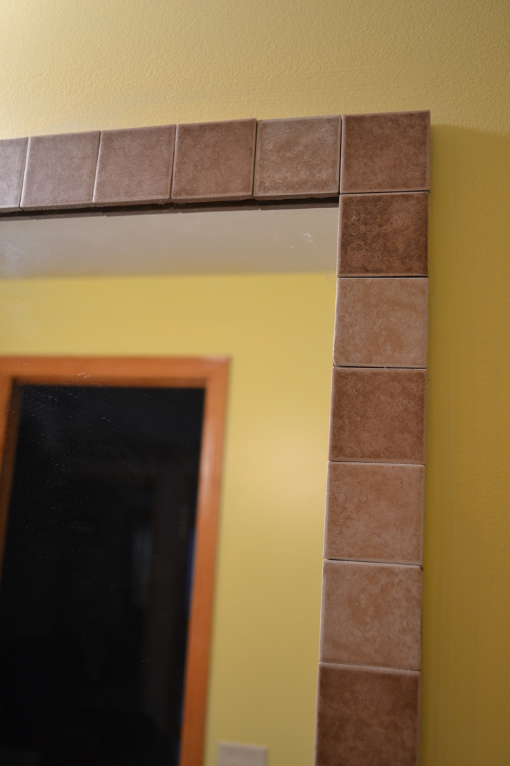 Tile border around a standard bathroom mirror. So easy and very cost ...