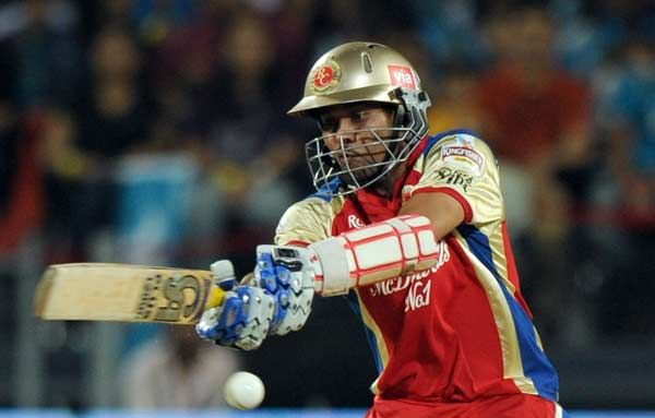 Royal Challengers Bangalore batsman Tillakaratne Dilshan plays a shot during the IPL Twenty20 cricket match between Pune Warriors India and Royal Challengers Bangalore at  Subroto Roy Sahara Stadium in Pune on May 11, 2012.