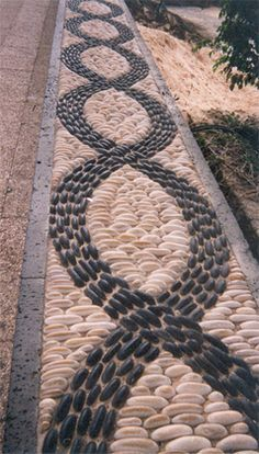Black and White Polished Pebble Mosaic RS.jpg (239×420) I know it's not concrete, but concrete is made from stone. haha LOVE IT!!