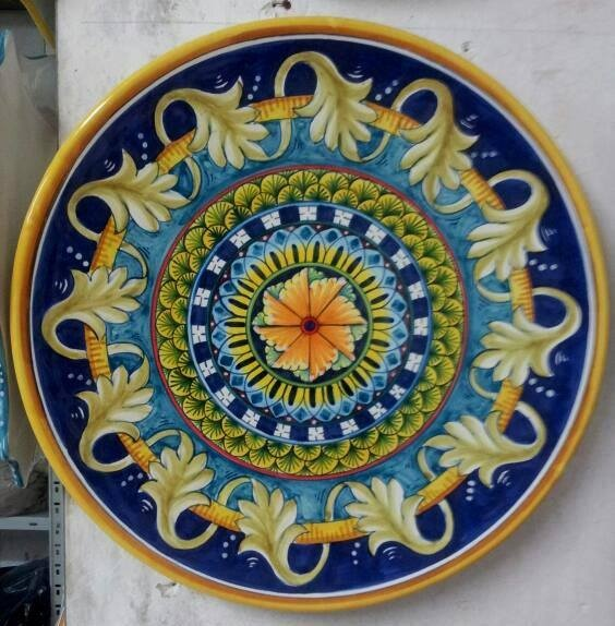 Beautifully hand crafted and hand painted wall plate. Available for sale at: www.romeocuomoceramics.com