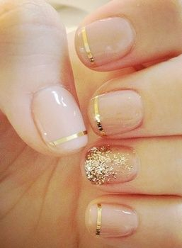 So sophisticated! Find out how to get this gold+nude nail art idea here..