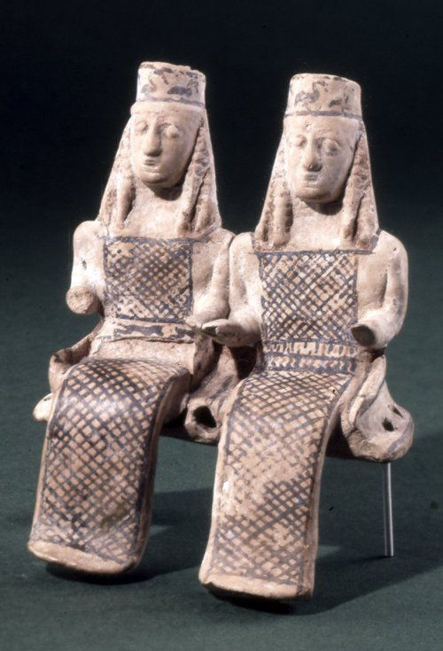 Terracotta model of two female figures, perhaps Demeter and Persephone, seated in a cart.  c.600 BC  Found at Thebes, Greece  Archaic Greek  (Source: The British Museum)