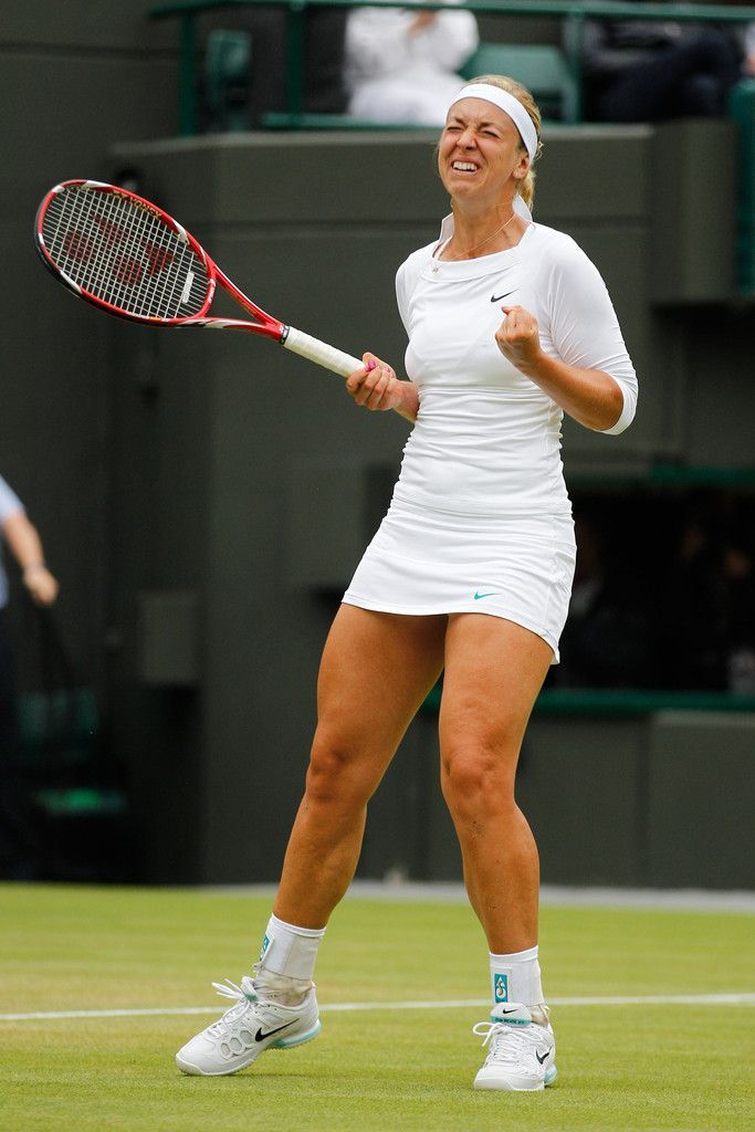 Sabine Lisicki Photos - Sabine Lisicki of Germany celebrates match point during her Ladies' singles fourth round match against Maria Sharapova of Russia on day seven of the Wimbledon Lawn Tennis Championships at the All England Lawn Tennis and Croquet Club on July 2, 2012 in London, England. - Sabine Lisicki Photos - 1677 of 2328
