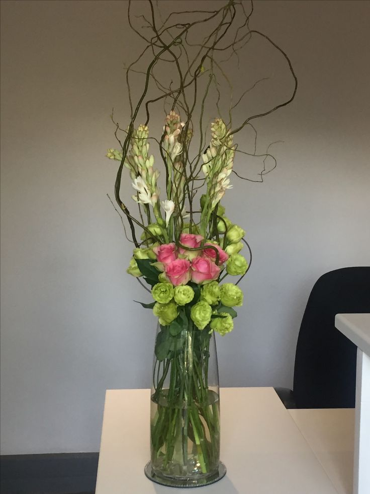 Lisianthus, roses, tuberoses and curly willow