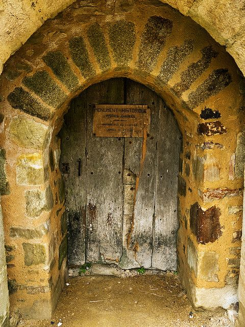 incredibly ancient door of French castle...  i think this needs to be our entrance to the wine cellar