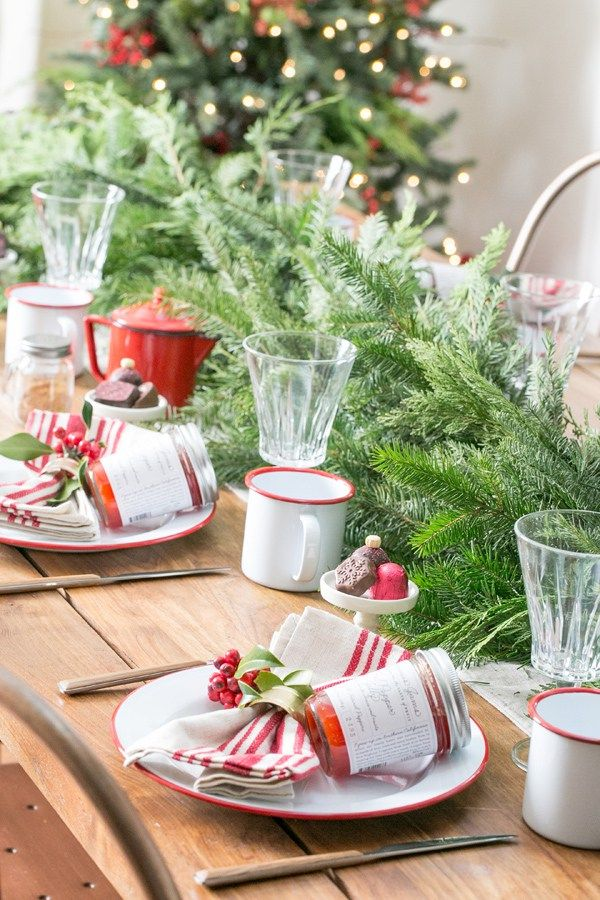 Keep Christmas decor traditional and charming with a lot of garland, wreaths, red berries, and beautiful garden roses. The scent of the holidays will emanate from the greenery in your dining area! Use a mix of classic, white enameled plates and cups, wooden utensils and a crystal glass to set the table. Keep it simple, but still charming with more pointers you can find here: http://sugarandcharm.com/2014/12/charming-christmas-brunch.html
