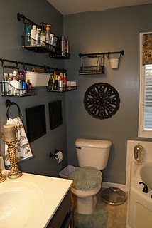 Use Ikea kitchen wall baskets and rails in bathroom to organize toiletries.
