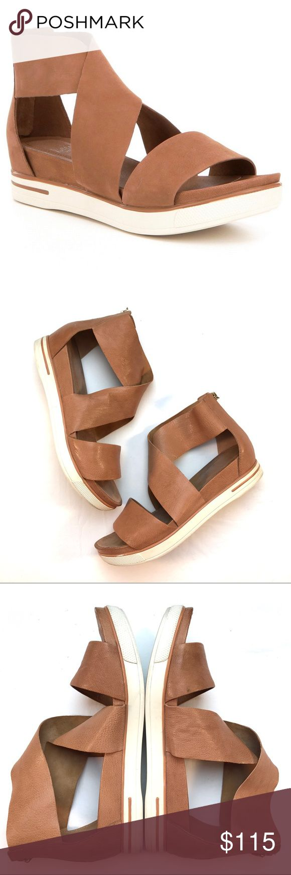 Eileen Fisher Leather Criss Cross Sport Sandals Eileen Fisher Tumbled Leather Criss Cross Banded Backstrap Sport Sandals in Camel. Soft leather straps. Rubber soles. Zip up the back. Gently worn and in great used condition. Small scuff on the front of the left Sandal. See pic 2. Size 9. Open to reasonable offers and any questions! Eileen Fisher Shoes Sandals