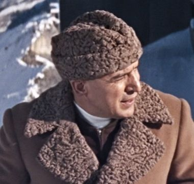 Telly Savalas as Ernst Stavro Blofeld wearing a brown Astrakhan fur hat and  matching brown overcoat. From the James Bond movie