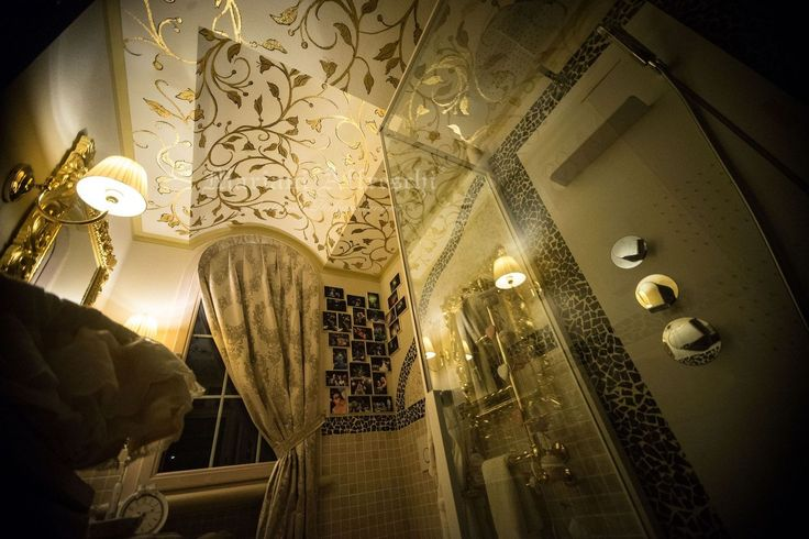 Gold-leaf decorations created by skilled artists add elegance and sophistication to any bathroom, even small ones