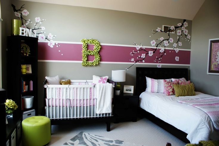 How fabulous is this accent wall in this nursery? Love the touch of #radiantorchid. #nursery #accentwall