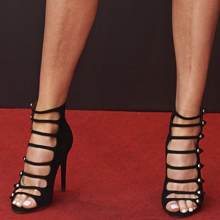 Charlize Theron wearing button-embellished 'Camilla' booties from Tabitha Simmons