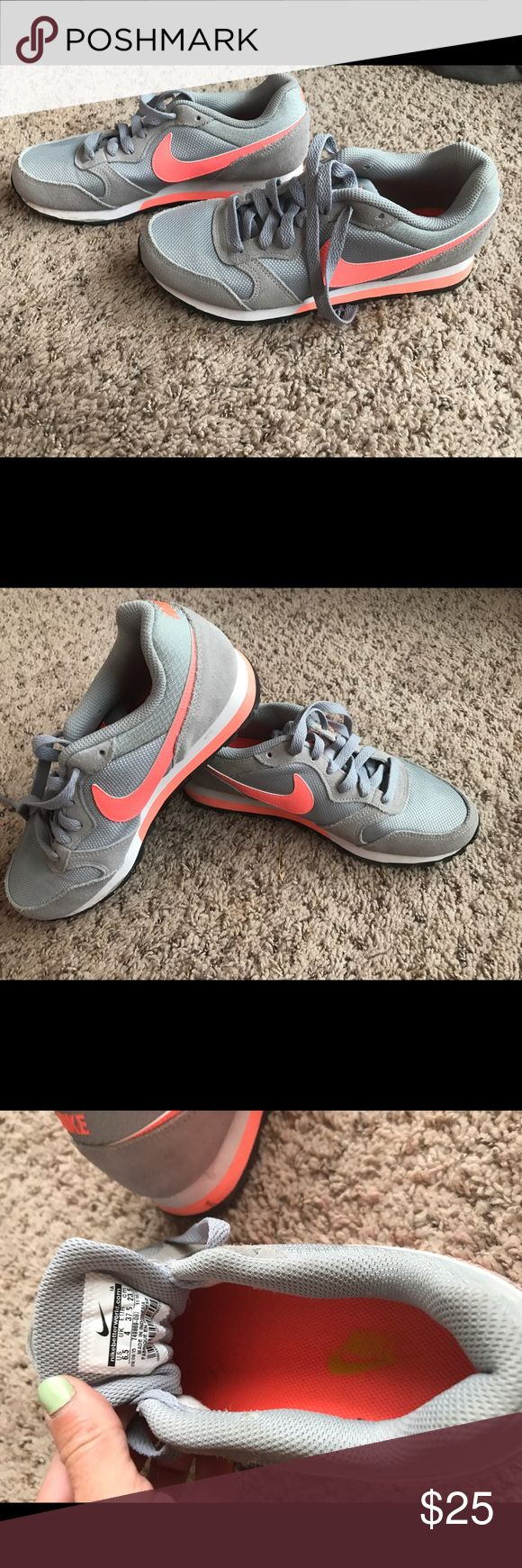 Ladies Nike running shoes Grey and salmon/pink swoop. Worn only to walk around Disney World one day!  Very comfortable- I just don't wear tennis shoes! Nike Shoes Athletic Shoes