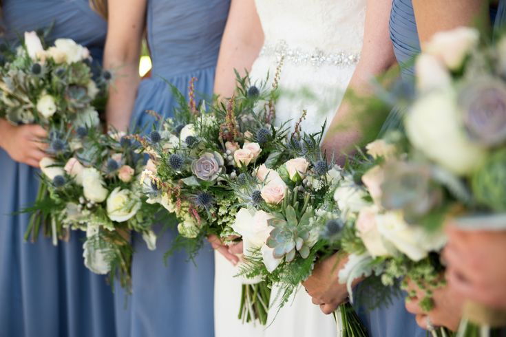 Slate blue bridesmaid dresses and wildflower wedding bouquets with blue thistle, pink roses, and succulents at Norfolk Zoo Wedding