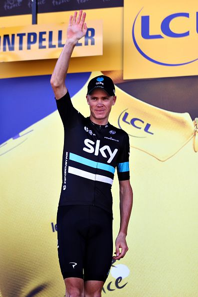 #TDF2016 Chris Froome of Great Britain riding for Team Sky walks onto the podium after retaining the yellow leaders jersey on stage eleven of the 2016 Le Tour...