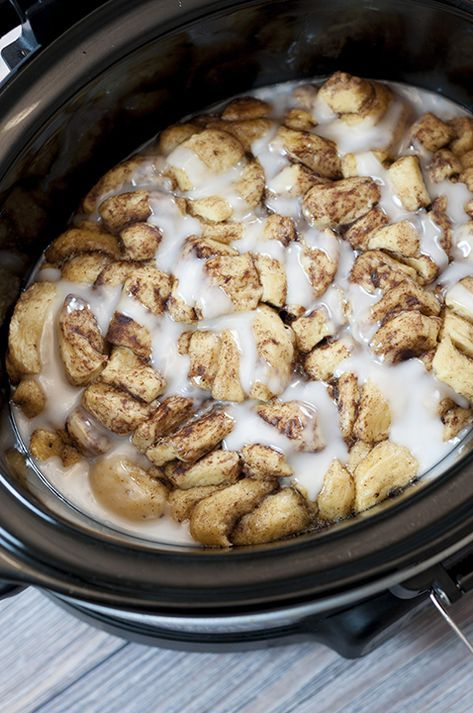 Simple, delicious, Gooey Crock Pot Cinnamon Roll Casserole recipe is sure to be a favorite for breakfast, brunch, the holidays or when you want breakfast for dinner! Your family will adore this!