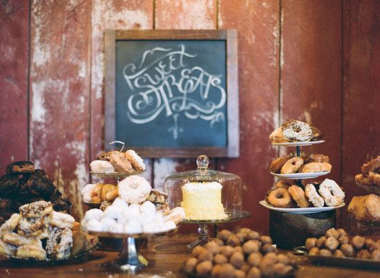 Rustic: For a rustic wedding, keep the cake small, create a buffet with doughnuts, and invite guests to join in with a chalkboard sign. Its a unique and affordable way to serve up desserts at a causal or Southern reception.  Photo by Lexia Frank Photography via Style Me Pretty
