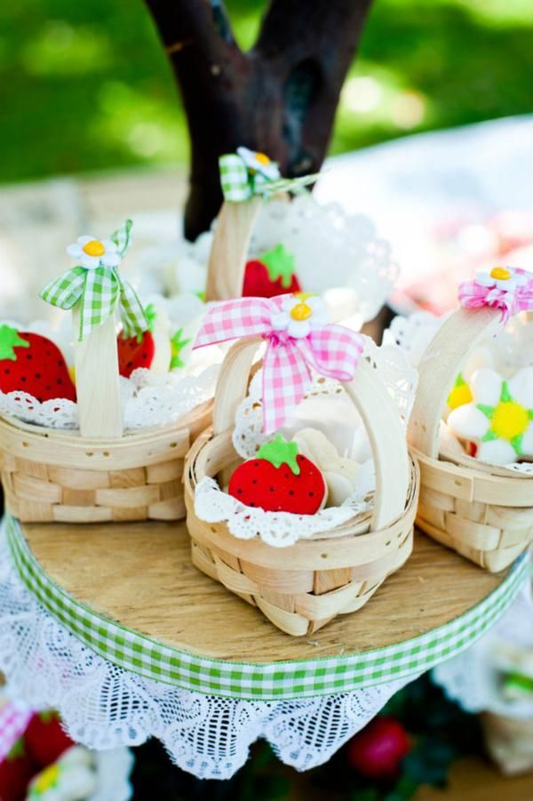 favor baskets for a strawberry party.