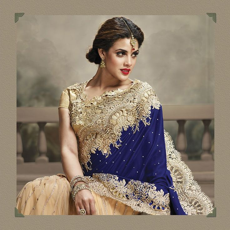 Royal blue velvet and golden net saree with diamond work.