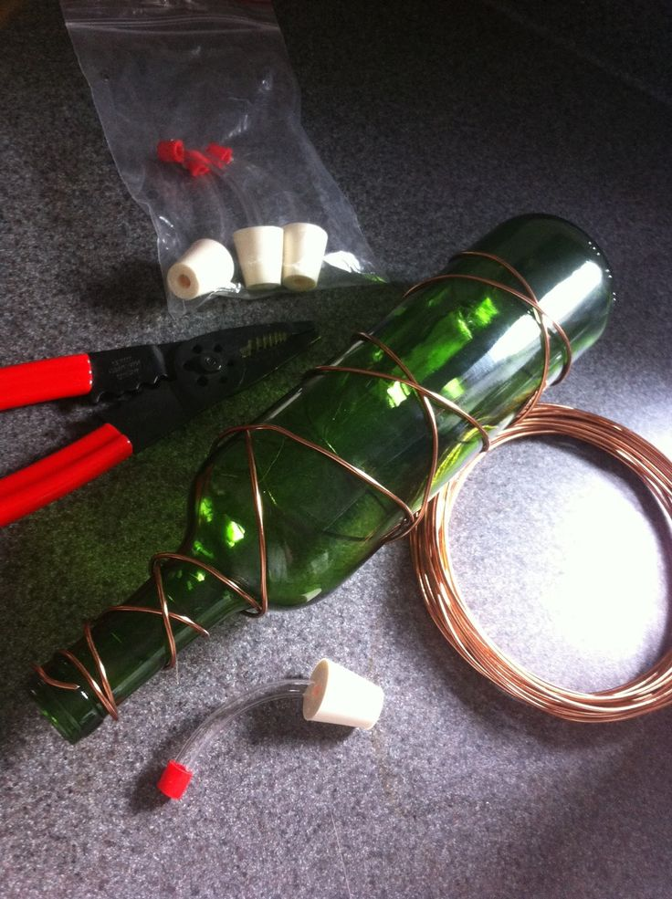 How to make a wine bottle hummingbird feeder. They're beautiful hanging outdoors on your home or in the landscape and they take only a few minutes to create! See the full article @ http://www.containerwatergardens.net/make-wine-bottle-hummingbird-feeder