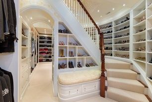 Traditional Closet with Custom closet storage, Archway, Woman's shoe storage open shelving, Built in drawers, Carpeted stairs