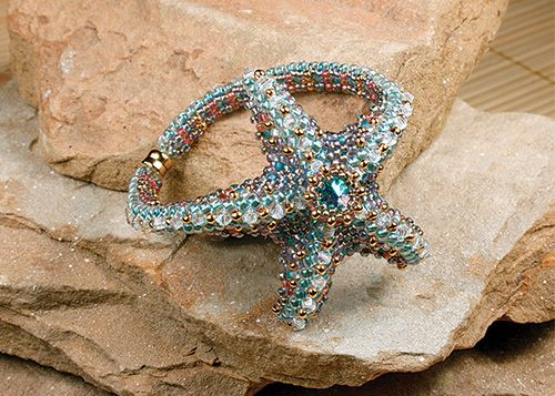 Tropical Sea Starfish $65 Sunday, February 16 (10am-5pm) This breezy sea starfish is bold, delicate and playful! It measures two inches across and encrusted with glistening crystals and dotted with a rivoli jewel in the center. This bracelet is a dimensional bangle style and a comfort to wear. It is made with peyote and herringbone techniques. Basic peyote and herringbone stitch experience is required. Materials list.