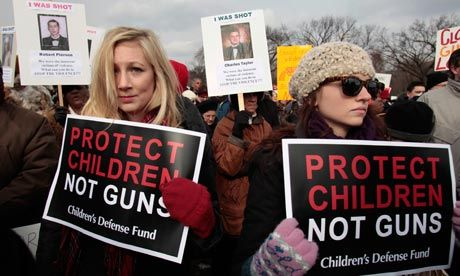 "Thousands of people, many holding signs with the names of gun violence victims and messages such as ""Ban assault weapons now,"" joined a rally for gun control on Saturday, marching from the Capitol to the Washington Monument. Participants were led by Washington mayor Vincent Gray and other officials, and the crowd stretched for about two blocks along Constitution Avenue. Police blocked off half the road. Participants held signs reading ""Gun control now"" and ""Stop NRA"""