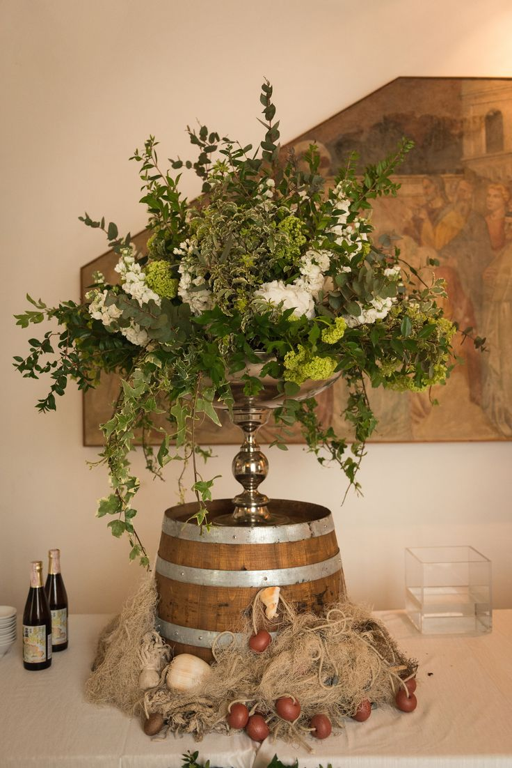 Buffet decoration with greenery and white flowers composition
