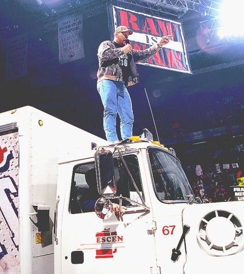 """Stone Cold"" Steve Austin drives a beer truck to the ring, gives The Rock and the McMahons a beer bath: March 22, 1999  One of the all-time great moments from Monday Night Raw: The Texas Rattlesnake drives a Coors Light truck to the ring and gives The Rock, Vince McMahon and Shane McMahon a beer bath. I really hope this made it into the WWE '13 game.  [[MORE]]"
