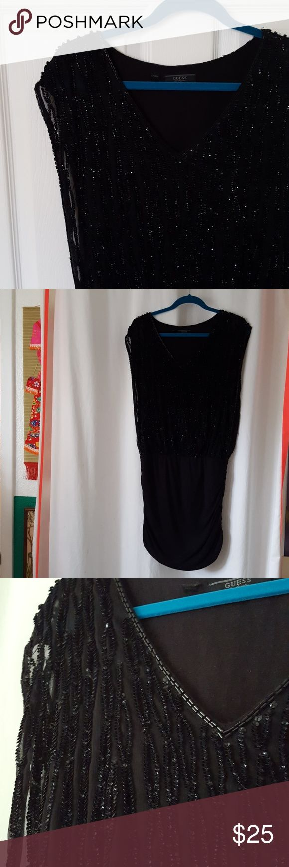 "Mini tunic dress Gorgeous mini dress with sheer beaded and sequin overlay at top. Perfect LBD for girls night out! Also works as a layering piece over skinny jeans or leggings. Dress has ruched sides and measures 36"" from shoulder to hem line. Guess Dresses Mini"