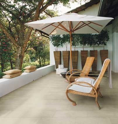 #Porcelain #tiles outdoors can simply be washed down with a garden hose and left to dry. #UnionTiles #patio
