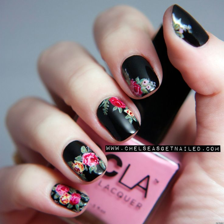 Black with flower art, would be even lovelier in matte... be sure to check out the other nail ideas on the page