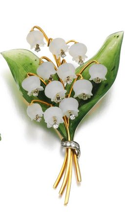 A gem set and diamond brooches, circa 1960.  A brooch designed as a spray of lily of the valley, set with carved nephrite and rock crystal, the flower heads suspending brilliant-cut diamonds.