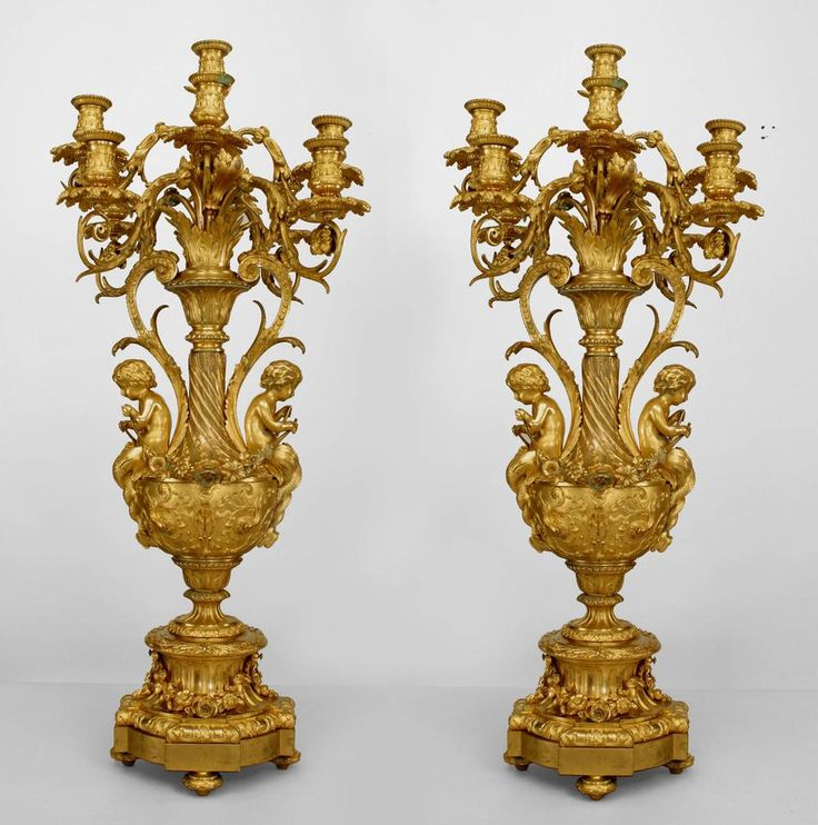 Pair of French Louis XV style (19th c.) bronze dore urn shaped 9 arm candelabra with scroll design arms and 2 cupids holding garland