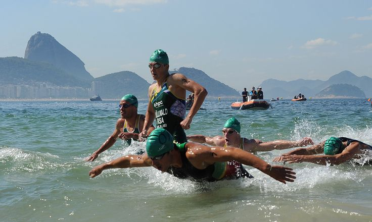 Athletes compete during the Men's Triathlon test event in Copacabana, Rio de Janeiro, on August 2, 2015. AFP PHOTO/TASSO MARCELOTASSO MARCELO/AFP/Getty Images (2000×1196)