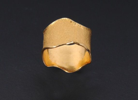 This handmade 22k ring of solid yellow gold is made with special reticulation technique. It combines mat and glossy finish. The width of the